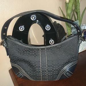 Coach black canvas bag w bottom & strap leather